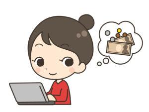 パソコンを使いながら、お金のことを考える女性