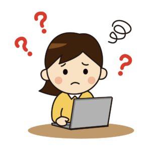 パソコン操作に悩む女性