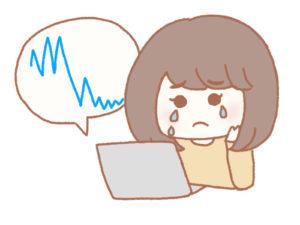 チャートを見て泣く女性