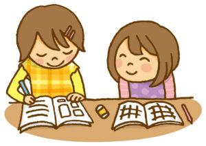 勉強を教えてもらう子ども